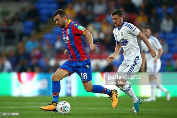 James McArthur of Crystal Palace takes the ball away from Danny Rowe of Ipswich during the Carabao Cup Second Round match between Crystal Palace and...