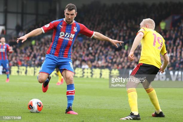 James McArthur of Crystal Palace taking on Will Hughes of Watford during the Premier League match between Crystal Palace and Watford at Selhurst Park...