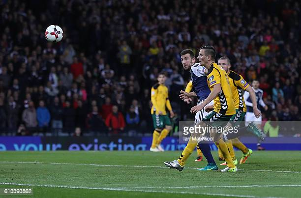 James McArthur of Scotland scores during the FIFA 2018 World Cup Qualifier between Scotland and Lithuania at Hampden Park on October 8 2016 in...