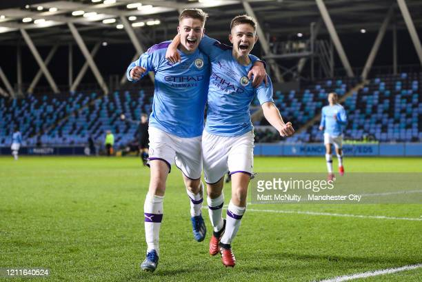 James McAtee of Manchester City celebrates with Liam Delap after scoring his teams third goal during the Under 18's Premier League 2 Cup Final at The...
