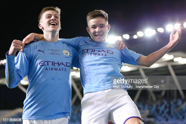 James McAtee of Manchester City celebrates with Liam Delap after scoring his teams fourth goal during the Under 18's Premier League 2 Cup Final at...
