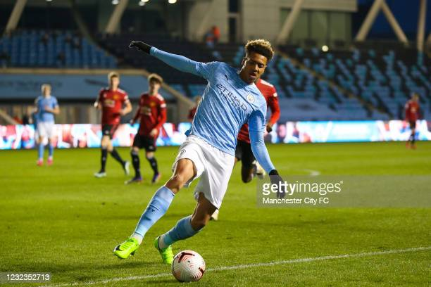 James McAtee of Manchester City controls the ball during the Premier League 2 match against Manchester United at Manchester City Football Academy on...