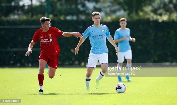 James McAtee of Manchester City U18 and Niall Brookwell of Liverpool U18 during a U18 Premier League match between Manchester City and Liverpool at...