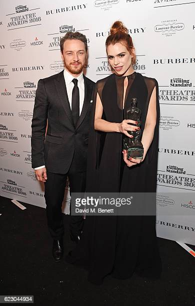 James McAvoy and Billie Piper winner of the Natasha Richardson Award for Best Actress pose in front of the winners boards at The 62nd London Evening...