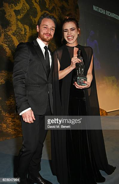 James McAvoy and Billie Piper, winner of the Natasha Richardson Award for Best Actress, pose onstage at the 62nd London Evening Standard Theatre...