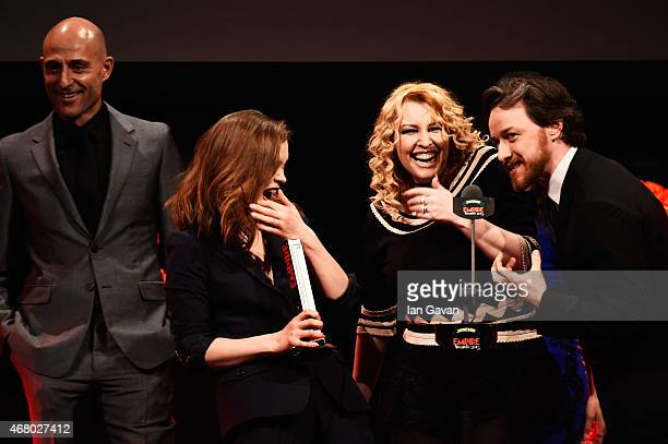 James McAvoy presents Mark Strong Sophie Cookson and Jane Goldman with the Best British Film Award for the Kingsman on stage during the Jameson...