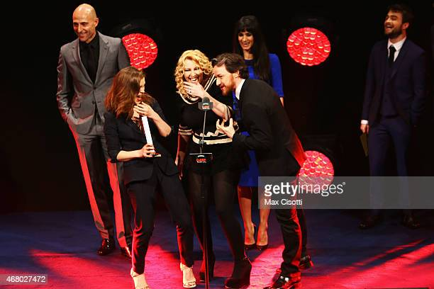 James McAvoy presents Mark Strong Sophie Cookson Sofia Boutella and Jane Goldman with the Best British Film Award for the Kingsman on stage during...