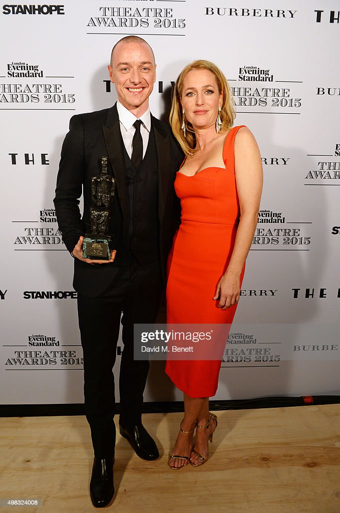 James McAvoy, winner of Best Actor for 'The Ruling Class', and Gillian Anderson pose in front of the Winners Boards at The London Evening Standard Theatre Awards in partnership with The Ivy at The Old Vic Theatre on November 22, 2015 in London, England.