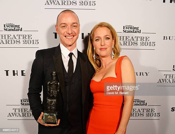 James McAvoy winner of Best Actor for 'The Ruling Class' and Gillian Anderson pose in front of the Winners Boards at The London Evening Standard...