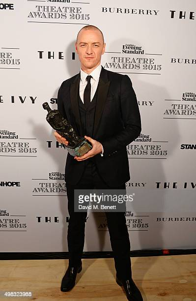 James McAvoy winner of Best Actor for 'The Ruling Class' poses in front of the Winners Boards at The London Evening Standard Theatre Awards in...