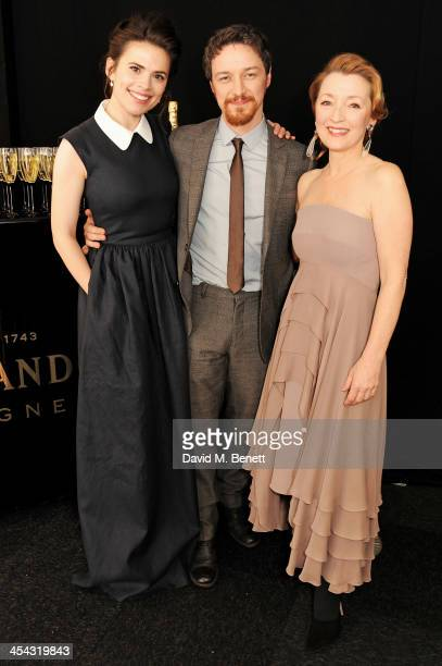 James McAvoy winner of the Best Actor Award poses with presenters Hayley Atwell and Lesley Manville pose backstage at the Moet British Independent...