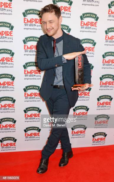 James McAvoy winner of the Jameson Best Actor Award poses in the press room at the Jameson Empire Awards 2014 at The Grosvenor House Hotel on March...