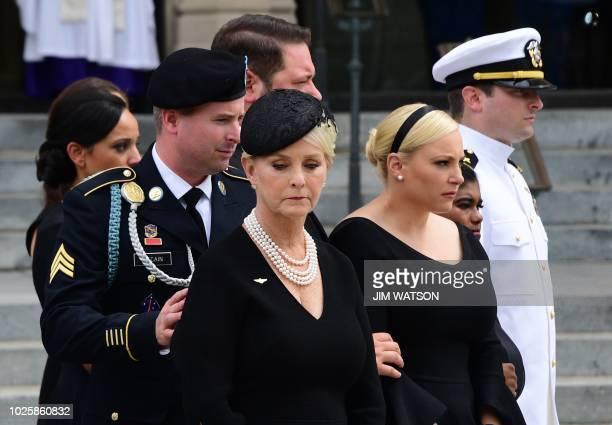 James McCain Cindy McCain Meghan McCain Bridget McCain John Sydney McCain watch as a Military Honor Guard carries the casket of US Senator John...
