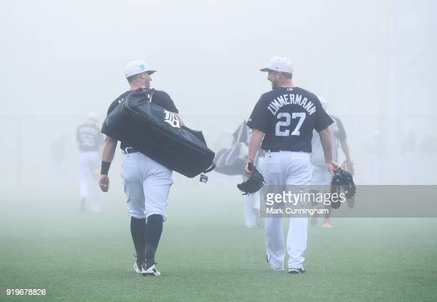 James McCann and Jordan Zimmermann of the Detroit Tigers walk across the field together in the fog during Spring Training workouts at the TigerTown...