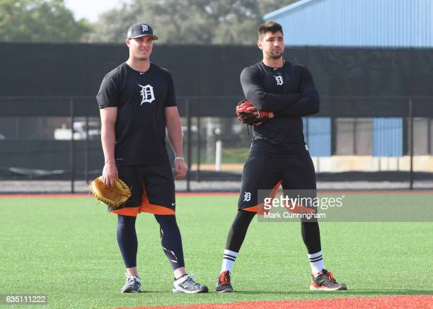 James McCann and Nick Castellanos of the Detroit Tigers look on during Spring Training workouts at the TigerTown complex on February 13 2017 in...