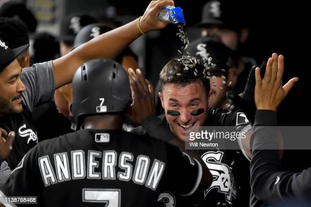 James McCann of the Chicago White Sox celebrates with teammates after hitting a three-run home run in the fifth inning against the Baltimore Orioles...