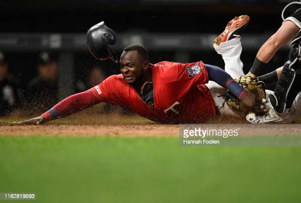 James McCann of the Chicago White Sox defends home plate against Miguel Sano of the Minnesota Twins during the sixth inning of the game on August 19...