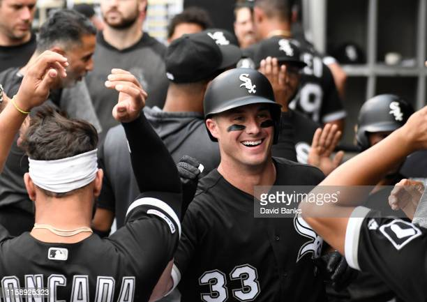 James McCann of the Chicago White Sox is greeted after hitting a two tun home run against the Minnesota Twins during the first inning at Guaranteed...