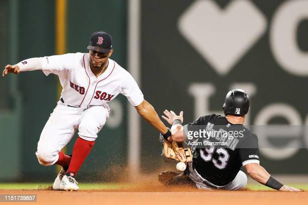 James McCann of the Chicago White Sox steals second base past the attempted tag by Xander Bogaerts of the Boston Red Sox in the eighth inning of a...