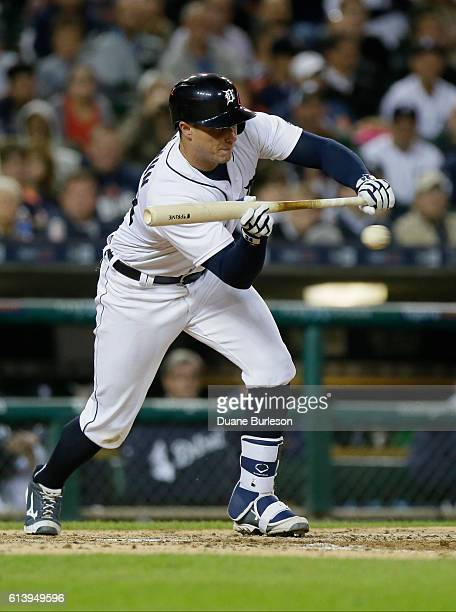 James McCann of the Detroit Tigers bunts against the Cleveland Indians at Comerica Park on September 26 2016 in Detroit Michigan