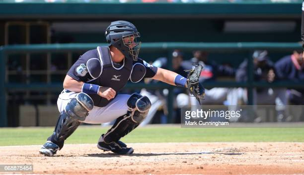 James McCann of the Detroit Tigers catches during the Spring Training game against the Atlanta Braves at Publix Field at Joker Marchant Stadium on...