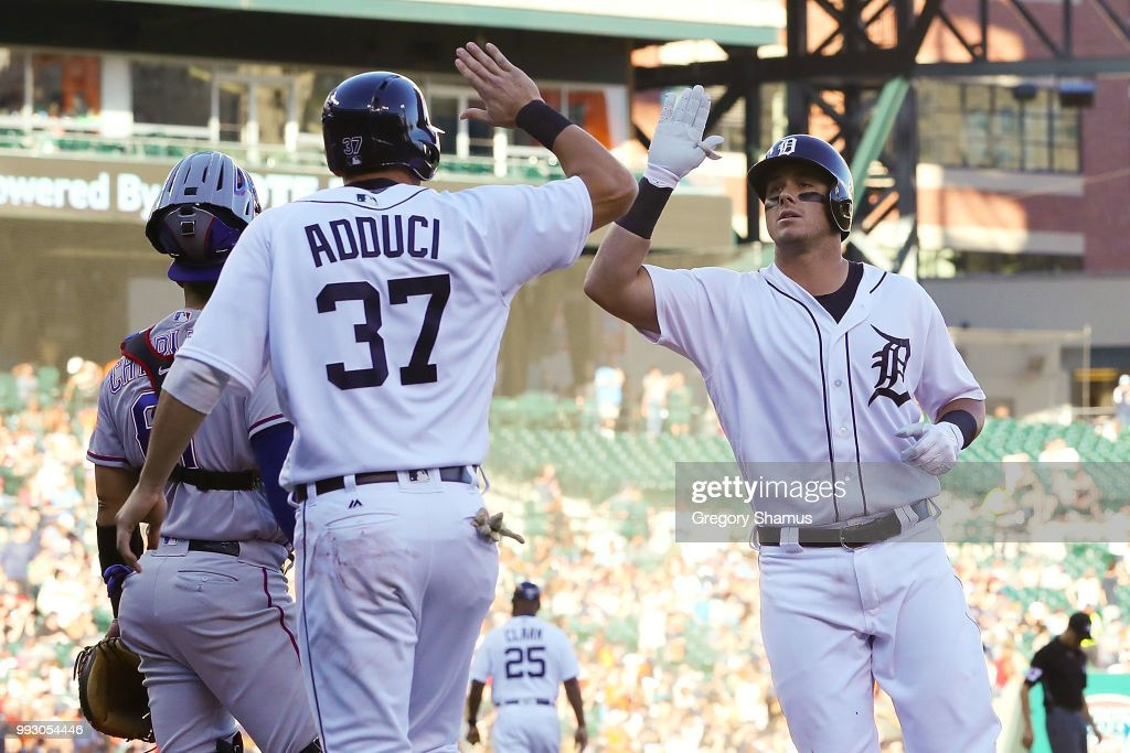 James McCann #34 of the Detroit Tigers celebrates his two run second inning home run with Jim Adduci #37 while playing the Texas Rangers at Comerica Park on July 6, 2018 in Detroit, Michigan.