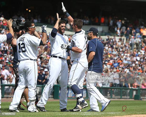James McCann of the Detroit Tigers celebrates his walk off home run in the ninth inning with teammates JD Martinez and Anthony Gose to win the game...
