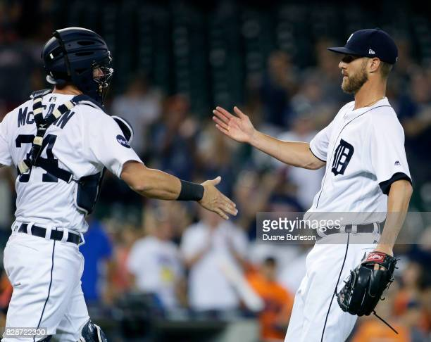 James McCann of the Detroit Tigers celebrates with Shane Greene of the Detroit Tigers after a 100 win over the Pittsburgh Pirates in an interleague...