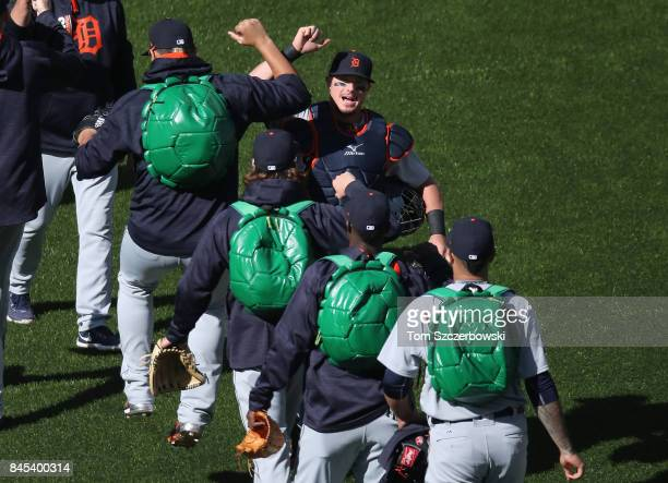 James McCann of the Detroit Tigers highfives relief pitchers wearing Teenage Mutant Ninja Turtles backpacks as they make their way to the bullpen...