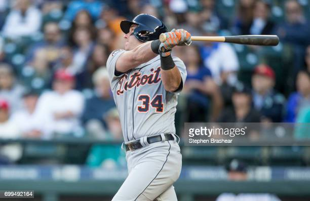 James McCann of the Detroit Tigers hits a solo home run off of starting pitcher James Paxton of the Seattle Mariners during the third inning of a...