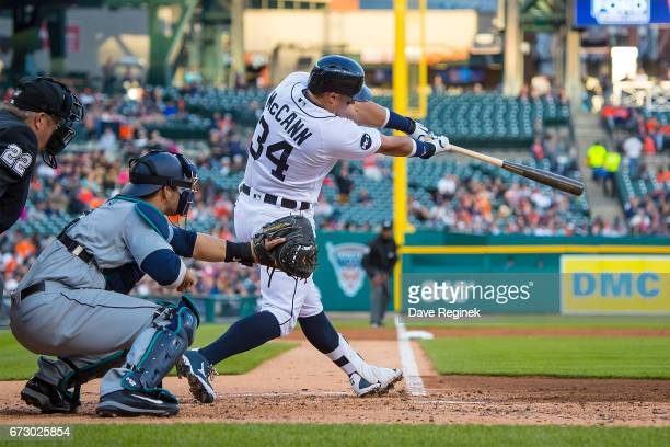 James McCann of the Detroit Tigers hits a three run homer in the second inning against the Seattle Mariners during a MLB game at Comerica Park on...