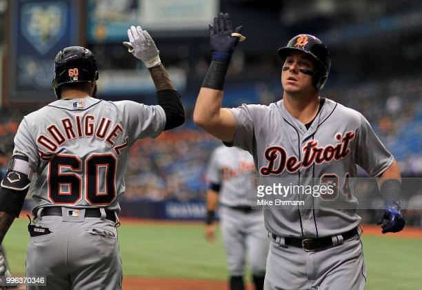 James McCann of the Detroit Tigers is congratulated after hitting a two run home run in the fourth inning during a game against the Tampa Bay Rays at...
