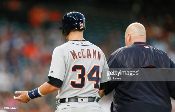 James McCann of the Detroit Tigers is hit on the hand by a pitch in the fourth inning against the Houston Astros at Minute Maid Park on May 25 2017...