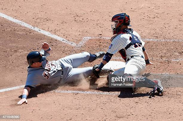 James McCann of the Detroit Tigers is out as Chris Herrmann of the Minnesota Twins defends home plate during the fifth inning of the game on April 29...