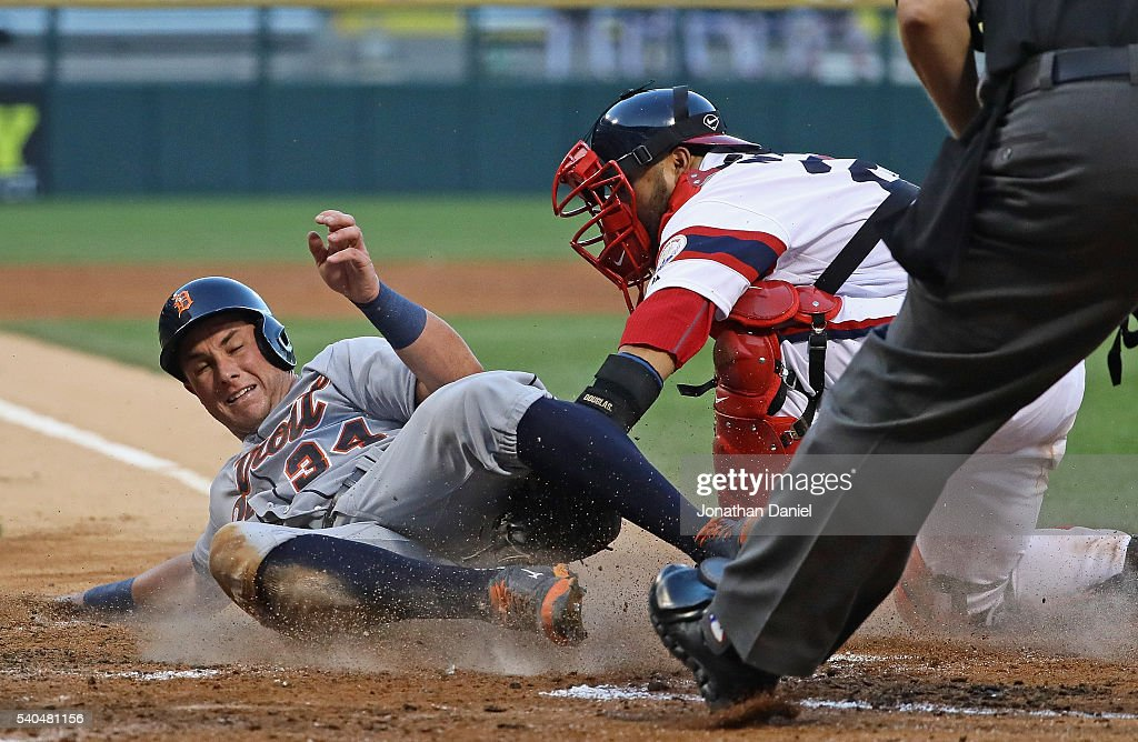 James McCann #34 of the Detroit Tigers is tagged out at the plate by Dioner Navarro #27 of the Chicago White Sox in the 3rd inning at U.S. Cellular Field on June 15, 2016 in Chicago, Illinois.