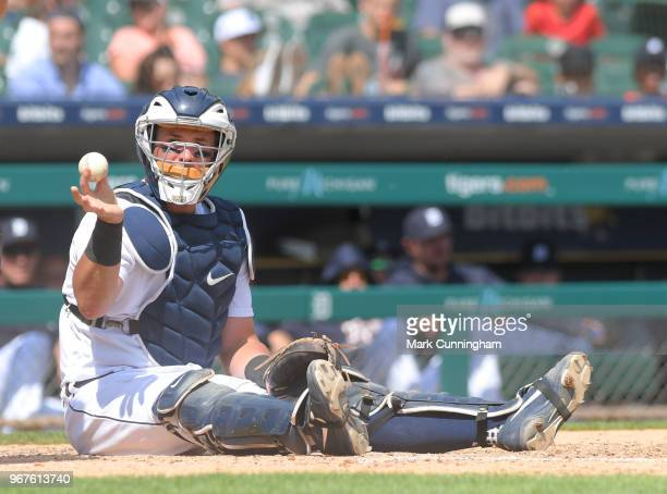 James McCann of the Detroit Tigers looks on while sitting on the field during the game against the Los Angeles Angels of Anaheim at Comerica Park on...