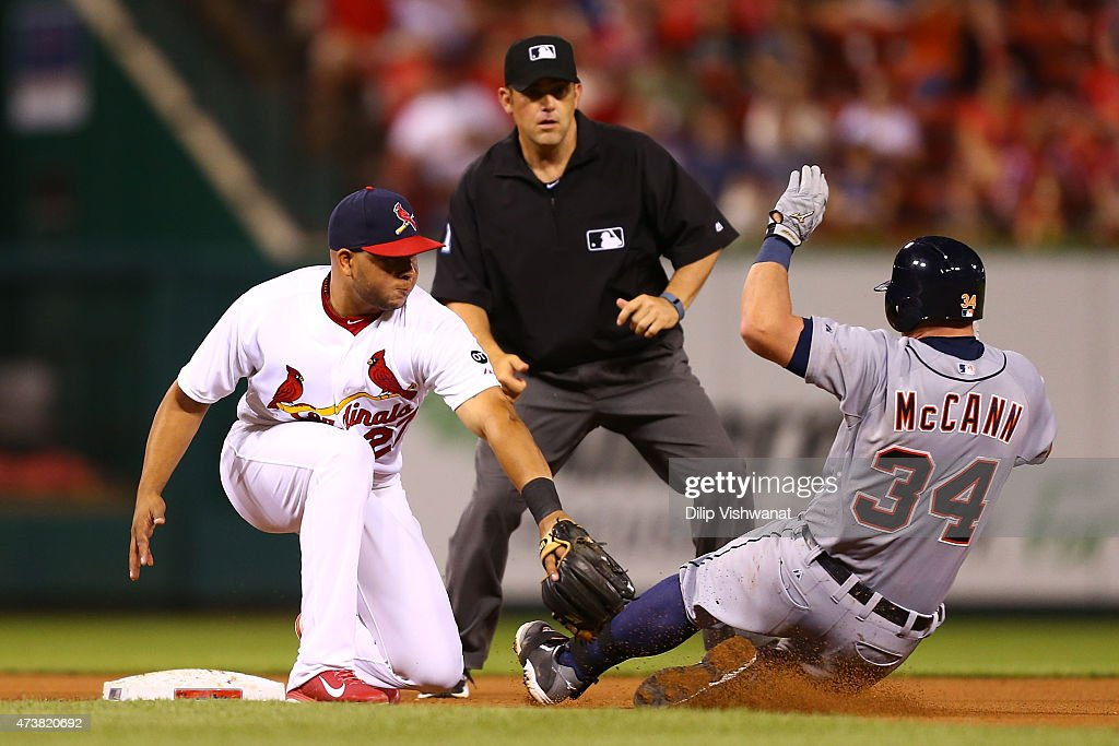 James McCann #34 of the Detroit Tigers slides into second base for a double against Jhonny Peralta #27 of the St. Louis Cardinals at Busch Stadium on May 17, 2015 in St. Louis, Missouri.