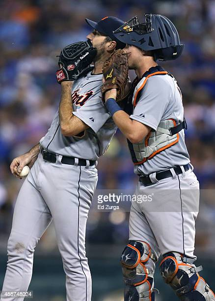James McCann of the Detroit Tigers talks with starting pitcher Justin Verlander in the sixth inning of a game against the Kansas City Royals at...