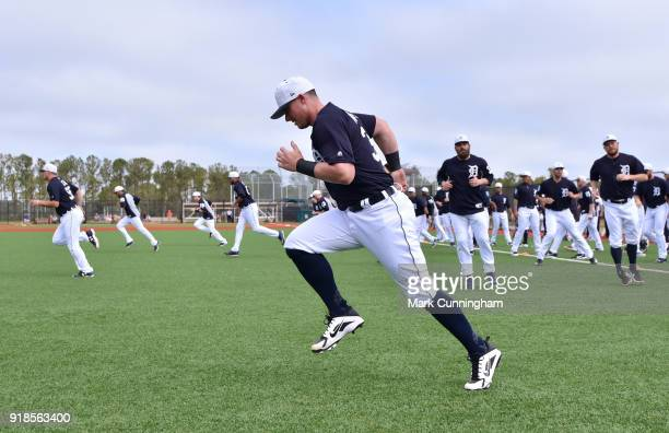 James McCann of the Detroit Tigers warmsup during Spring Training workouts at the TigerTown Facility on February 14 2018 in Lakeland Florida