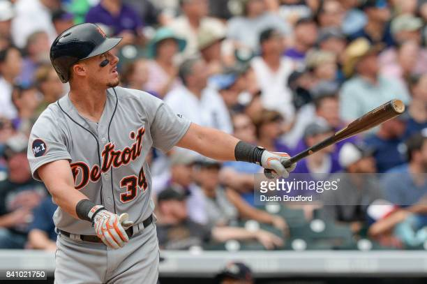 James McCann of the Detroit Tigers watches the flight of a fifth inning three run homerun hit against the Colorado Rockies at Coors Field on August...