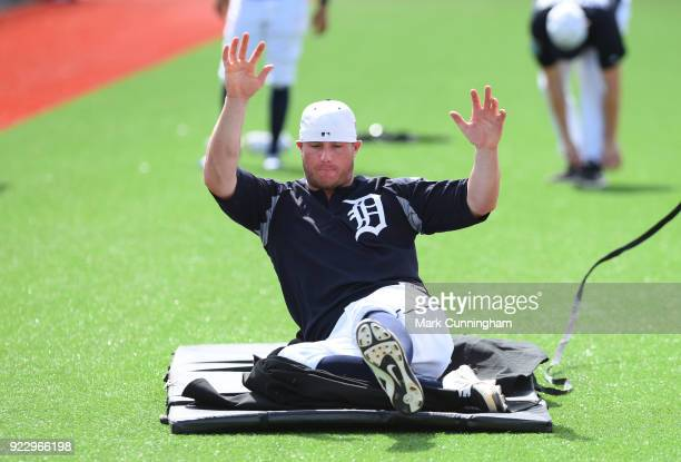 James McCann of the Detroit Tigers works on a sliding drill during Spring Training workouts at the TigerTown Facility on February 21 2018 in Lakeland...