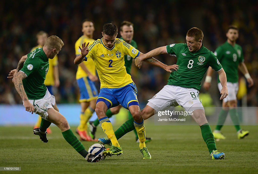 James McCarthy and James McClean of Republic of Ireland battles with Mikael Lustig of Sweden during the FIFA 2014 World Cup Qualifying Group C match between Republic of Ireland and Sweden at Aviva Stadium on September 6, 2013 in Dublin, Ireland.
