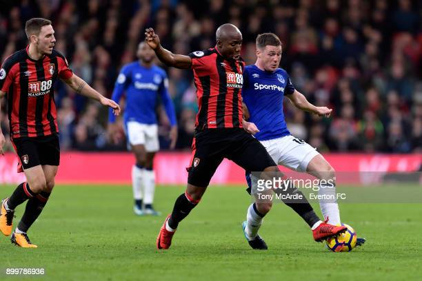 James McCarthy of Everton and Benik Afobe challenge for the ball during the Premier League match between AFC Bournemouth and Everton at the Vitality...