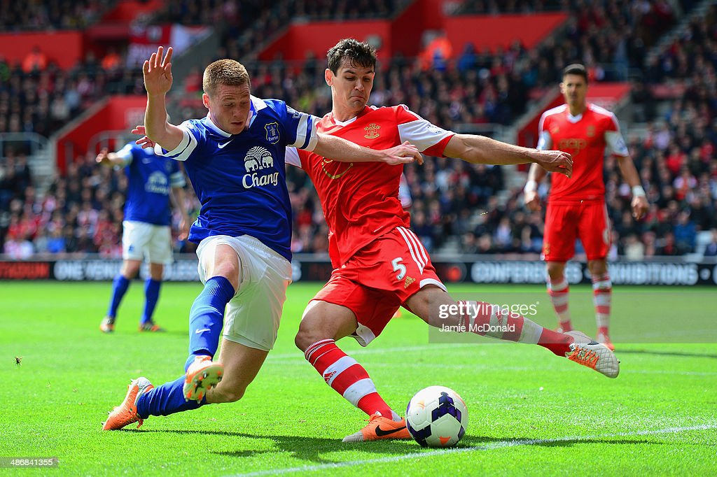 James McCarthy of Everton and Dejan Lovren of Southampton battle for the ball during the Barclays Premier League match between Southampton and Everton at St Mary's Stadium on April 26, 2014 in Southampton, England.