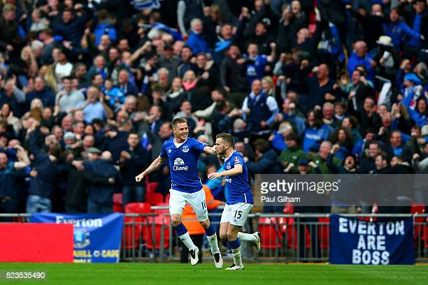 James McCarthy of Everton and Tom Cleverley of Everton celebrate after Chris Smalling of Manchester United scores an own goal during The Emirates FA...