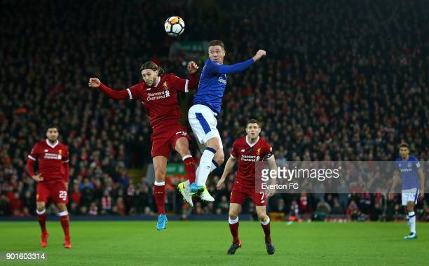 James McCarthy of Everton battles with Adam Lallana of Liverpool during the Emirates FA Cup third round match between Liverpool and Everton at...