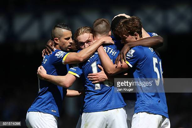 James McCarthy of Everton celebrates scoring his team's first goal with his team mates during the Barclays Premier League match between Everton and...