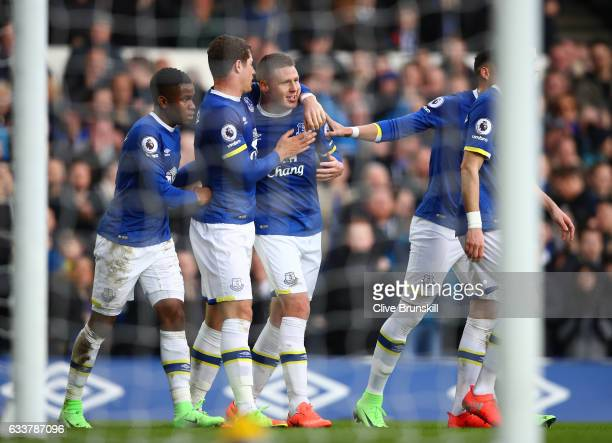 James McCarthy of Everton celebrates scoring his team's second goal with his team mates during the Premier League match between Everton and AFC...