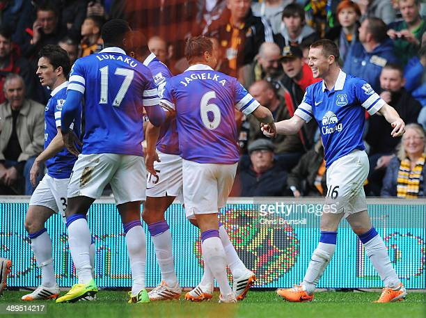 James McCarthy of Everton celebrates scoring the opening goal with team mates during the Barclays Premier League match between Hull City and Everton...