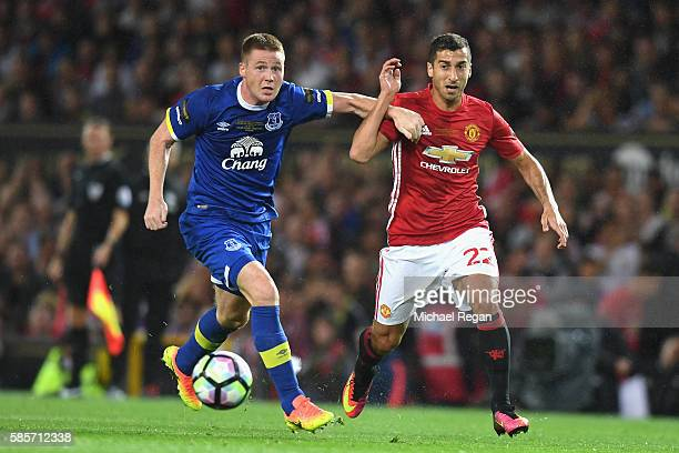 James McCarthy of Everton chases down Henrikh Mkhitaryan of Manchester United during the Wayne Rooney Testimonial match between Manchester United and...